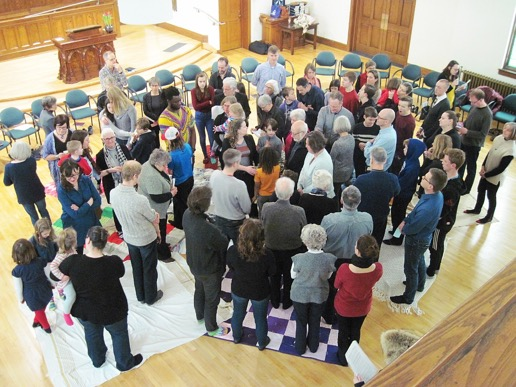 "On our retreat Sunday, February 11, we took part in the Kairos Blanket Exercise, in which we ""participated"" in the experiences of Indigenous peoples over the five centuries of colonization following the arrival of European explorers and settlers in North America. Here, at the beginning of the exercise, everyone is standing on a set of contiguous blankets."